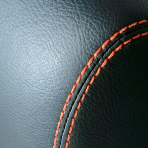 Close-up of artistic stitching.